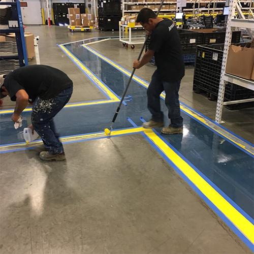 ArmourFlo industrial epoxy floor installers applying stripes